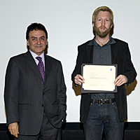 Justin Moore receives a NASA Space Act Award from JPL Director of Solar System Exploration, Firouz Naderi